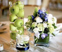 The centerpieces can be made from apples alone or a combination of apples, flowers and greeneries. I especially love the idea of arranging only apples inside a tall cylinder vase, like in the picture below: