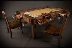 Geek Chic dining table that converts to a gaming table with space for individual areas and drink holders