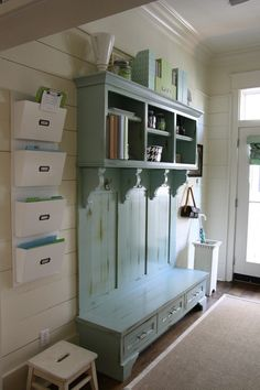 I love this look, but we need less space on top, more storage on bottom (for shoes).    Definitely want to replicate the separate mail-boxes / paper boxes, though.  And include a wall calendar.