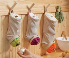 Vegetable Keep Sacks - these are brilliant, can be DIY'ed, cute, and just plain smart!
