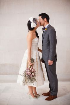 Monday afternoon, San Francisco City Hall wedding. Simple, yet so elegant. Love the veil and his bow tie.