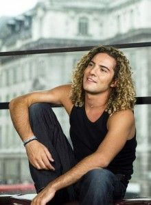 Spanish David Bisbal showing his shoulder length curly hairstyle
