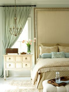 Putting a frame on a fabric headboard? Looks expensy but prob isnt...