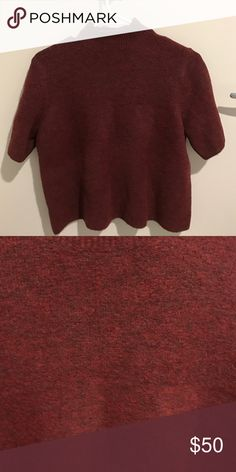 Ann Taylor loft sweater A cropped sweater with a mock turtle neck. Never been worn and still has tags on it. Maroon coloring! Made of Italian yarn. Ann Taylor Sweaters Cowl & Turtlenecks