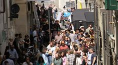 """Tom Hanks shooting his movie """"Inferno"""" in Florence. Can you spot him?"""