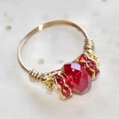 """Ruby Darling"" with Red Crystal & Crystal Rondelles Ring in 18ktgp Sizes 5 - 10 by Maru: https://www.outbid.com/auctions/31116-maru-s-dino-dlz4u#21"