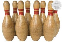 find two vintage bowling pins for bookends in the game room.