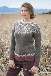 The Grand Forks Pullover showcases a traditional circular yoke with neutral tones and a pop of rich color. The corrugated ribbing at the hem and cuffs creates visual interest, and the waist shaping provides a flattering fit.