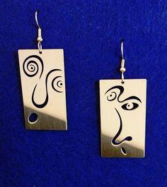Face earrings in nickel silver by ChristopherRoyal