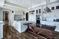 Kitchen with built-in table and gorgeous flooring | Veranda Estate Homes & Interiors