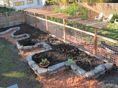 Keyhole Garden, Fence, Grape Trellis Part of garden fence