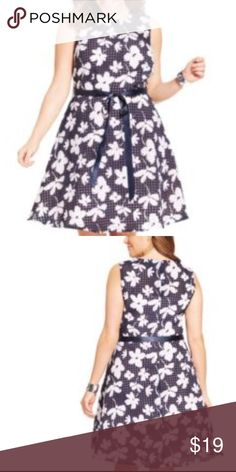 Plus Size Floral Flare Dress GUC No Tears or Stains. The tag actually fell off but I purchased this at Macy's without the sash but the dress still has a great flare look to it especially for a curvy plus size girl (I'm a size 20-22). Beautifully lined, colors are like a navy/black, depends on lighting...pattern is like a checkered or waffle pattern of navy/black over light navy/black if that  makes sense.  Florals are cream/white. Will look up fabric and post. S.L. Fashions Dresses Midi