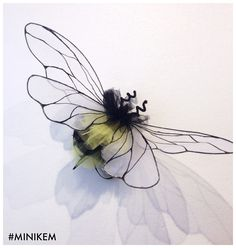 Bumble Bee Pom Pom, wearable art piece by Minikem.  Fairy wings costume, millinery, sewing crafts.