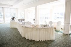 Hoover Country Club weddings. summer wedding. buffet table. living room. white linens. Birmingham, Alabama