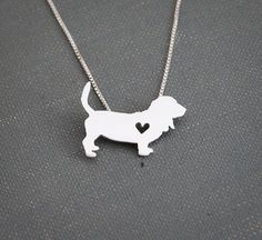 This sweet basset hound necklace is cut with a jewelers saw and soldered by hand. It is then tumbled for strength and a shiny finish, polished,