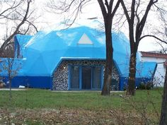 Bright blue igloo standing across from what remains of the Michigan Central train depot