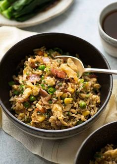 Close up of Egg Fried Rice in a dark brown bowl, ready to be eaten