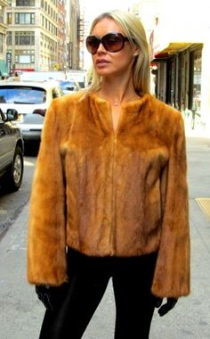 """Pre-Owned Whiskey Dyed Mink Bolero Jacket  Check out this dazzling Whiskey Dyed Mink bolero jacket. The silky male skins are from Denmark. It has the European collarless look and a great color. Very light weight, it is perfect for dressing up or dressing down. The jacket has hook & eyes closures and the lining is in perfect condition and this garment has no monogram.  Length: 29"""", armholes: 21"""", shoulders: 15"""", sweep: 48"""" and size: 10 - 12.  http://www.cowitfurs.com/fur-gallery"""