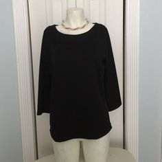 Ann Taylor Black ponte top. Beautiful top. Has 3/4 sleeves. Oval collar. Detail on the side gold zippers. Perfect condition. Ann Taylor Tops