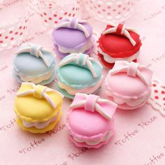 And colorful macaroons with ribbons on top via hellocute.tumblr.com