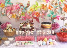 Pinwheel theme party for a baby's cutting his first tooth. Dessert table, pinwheel backdrop
