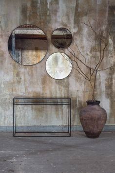 The Notre Monde bronze console and Heavy Aged mirrors.
