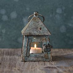 Aged Iron Miniature Lantern - Terrain - Don't see good ventilation here, so not sure how well an actual candle would burn in it. Cool though!