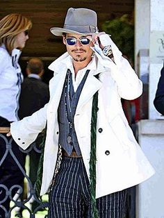 THE TIP-OFF A stylish Johnny Depp arrives in Italy for the Venice Film Festival Wednesday, where he presented his Charlie and the Chocolate Factory director Tim Burton with the Golden Lion Lifetime Achievement Award. Johnny Depp, Here's Johnny, Hot Actors, Actors & Actresses, Beautiful Men, Beautiful People, Celebs, Celebrities, Look Cool