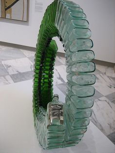 Untitled, by David Hammons. Wine bottles and silicon glue. Recycled Bottles, Recycled Crafts, Recycled Glass, Bottles And Jars, Glass Bottles, Milk Bottles, Recycling, Bottle Trees, Trash Art