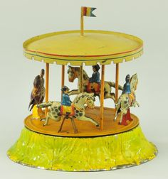 FLEISCHMANN CAROUSEL  Germany, early hand painted and lithographed tin