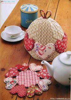 комплект: грелка на чайник и подставка....