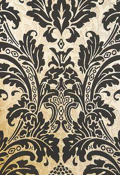 Blake Damask Wallpaper Metallic gold damask wallpaper with mottled pattern throughout and elegant matte black motif.