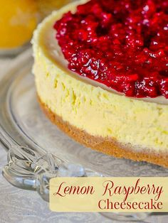 Lemon Raspberry Cheesecake. A silky smooth lemon cheesecake with just the right tangy lemon flavour topped by a complimentary sweet raspberry compote.