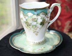 RS Prussia Scalloped Hand Painted Demitasse Tea Cup & Saucer set. $55.00, via Etsy.