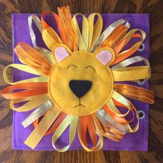 This Touch and Feel Lion is a single quiet book page to add to your very own custom quiet book! This colorful lion has a soft felt face with hand embroidery and a fun ribbon mane. The ribbons vary in texture, length, width, pattern, and color making this an exciting way for your child to engage in sensory exploration. Quiet Books are a fantastic way to keep your child busy while traveling, at a doctor appointment, during church, or anywhere that you need your little one quietly…