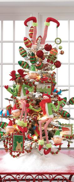 2013 RAZ Postmark Christmas Tree - see the list of products that RAZ used to decorate this tree at Trendy Tree http://www.trendytree.com/blog/2013-raz-postmark-christmas-decorated-trees/