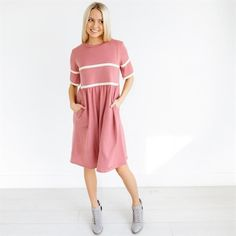 ​This dress is so sporty and chic!  The fit is very flattering and it has pockets!