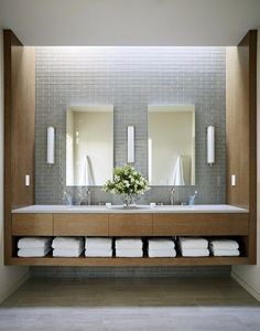Bathroom Decor grey In this modern bathroom, grey tiles have been combined with wood cabinetry that has an open shelf for towel storage. Bathroom Vanity Designs, Modern Bathroom Design, Bathroom Interior Design, Bathroom Ideas, Bathroom Vanities, Modern Bathroom Lighting, Contemporary Bathrooms, Bad Inspiration, Bathroom Inspiration