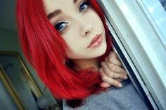 Gorgeous redhead with piercing done.
