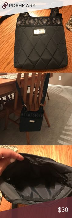 Cinda b cross body purse Very clean purse used once for a day nothing wrong with it..  black cross body purse 👛 water resistant cinda b Bags Crossbody Bags