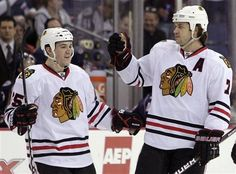 Chicago Blackhawks' Brent Seabrook, right, celebrates his goal against the Columbus Blue Jackets with teammate Andrew Shaw during the first period of an NHL hockey game, Tuesday, March 20, 2012, in Columbus, Ohio. (AP Photo/Jay LaPrete)