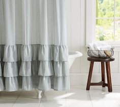"""Ruffle Shower Curtain #potterybarn  A wide hem of romantic ruffles gives this airy cotton voile curtain subtle elegance.  72"""" square  100% cotton.  Monogramming is available for an additional charge.  Monogram is 8"""" in height and in very center of front of curtain.  Machine wash.  Imported. $69"""