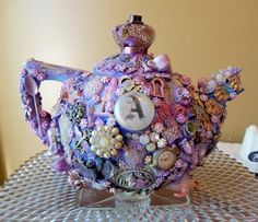 a mad tea party... Altered art, teapot, mixed media collage, costume jewelry.... Awesome!