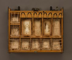 """for Phaedra - this installation is titled """"the odd volumes of ruby b.""""    ;) ... so cool. I have a vintage cash register drawer that I'm altering right now. Hope it looks this cool when I'm done."""
