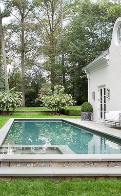 Iron furnishings, antique planters, and a manicured lawn lend this pool a decidedly Parisian feel. Photo by Erica George-Dines. Backyard Pool Designs, Swimming Pools Backyard, Swimming Pool Designs, Pool Landscaping, Lap Pools, Indoor Pools, Outdoor Pool, Outdoor Spaces, Outdoor Living