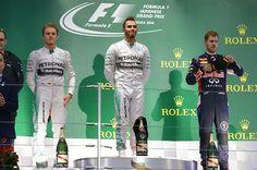Podium and results: 1st Lewis Hamilton (GBR) Mercedes AMG F1, centre. 2nd Nico Rosberg (GER) Mercedes AMG F1, left. 3rd Sebastian Vettel (GER) Red Bull Racing, right. Formula One World Championship, Rd15, Japanese Grand Prix, Race, Suzuka, Japan, Sunday, 5 October 2014