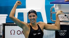 Dana Vollmer celebrates after winning the gold  medal and setting a new world record time of 55.98 seconds in the Women's 100m Butterfly final on the Day 2 of the London 2012 Olympics.