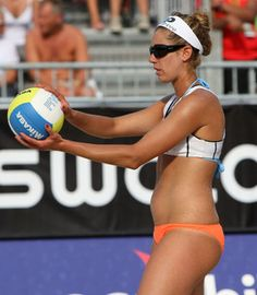 April Ross gets ready to serve on June 26 at the FIVB Beach Volleyball World Championships