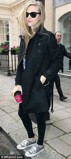 Smart and casual: Amanda's coat looks good with smart flats, as well as leggings and Converse trainers