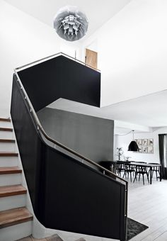 Black, white, and gray entryway and staircase looking into dining room
